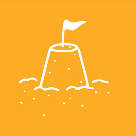 yellow and white graphic of sand castle with flag sticking out